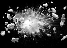 Explosion. Split debris caused by explosion against black background Stock Image