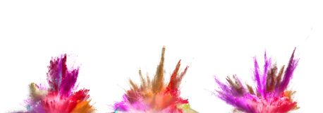 Explosions of coloured powder isolated on white background. royalty free stock photography
