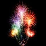 Explosions de feux d'artifice sur le fond noir Photo stock