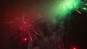 Explosive and colorful holiday fireworks at night sky. stock footage