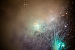 Explosive and colorful holiday fireworks at night sky. royalty free stock photo