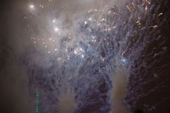 Explosive and colorful holiday fireworks at night sky. stock photography