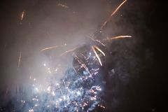 Explosive and colorful holiday fireworks at night sky. royalty free stock photos