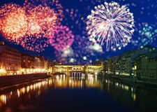 Florence with fireworks - Celebrating New Year in the city. Explosive fireworks around Ponte Vecchio on River Arno - Celebrating New year`s eve in Florence Royalty Free Stock Image