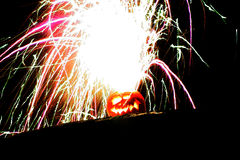 An explosive Jack'o latern. A pumpkin with an fire hair style royalty free stock photo