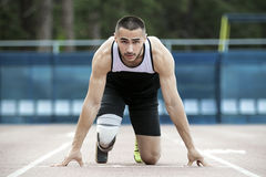 Explosive start of athlete with handicap royalty free stock photo