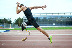 Explosive start of athlete with handicap. At the stadium Royalty Free Stock Photography