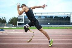 Explosive start of athlete with handicap Royalty Free Stock Photography