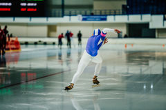 Explosive start athlete speed skater. To sprint on ice rink. competitions in speed skating Stock Images