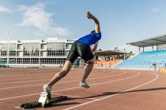 Explosive start men runner stock photography
