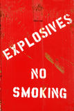 Explosives. No Smoking painted on a bunker at a city shop building Royalty Free Stock Images