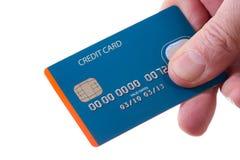 Explotación agrícola de la mano de la tarjeta de crédito Foto de archivo libre de regalías