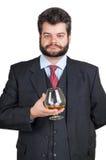 Explotación agrícola del hombre de negocios en un vidrio de whisky imagenes de archivo