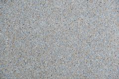 Explsed aggregate finish concrete wall and floor background texture. For decoration stock image