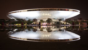 EXPO 2010 Shanghai. Shanghai/China: The main concert and media hall mirrored in an small lake at nighttime at the largest World Expo 2010 in Shanghai, China stock image