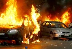 Expo 2015: Carros ateados fogo por blocos pretos Fotos de Stock Royalty Free