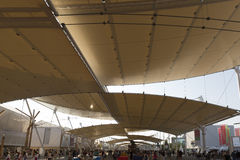 Expo 2015 Milan - Italy. Milan, Italy – 12 August 2015: Start of the 1.5km roofed main street of the Expo 2015, theme: Feeding the Planet, Energy for Life Royalty Free Stock Image