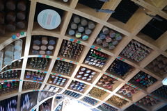 Expo 2015 Milano. Unusual original ceiling made of wooden squares with food items in boxes and cylinders inside the squares Stock Photos