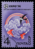 EXPO. USSR - CIRCA 1974: A stamp printed in the USSR devoted EXPO-74 shows a swallow on a background of clouds and rainbows and an inscription - all for the stock image