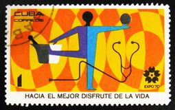 `EXPO 70 World Fair, Osaka, Japan` with inscription Towards the greater enjoyment of life, circa 1970. MOSCOW, RUSSIA - JULY 15, 2017: A stamp printed in Cuba Royalty Free Stock Image