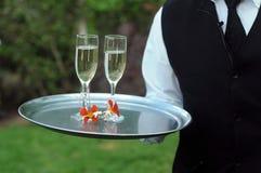 Exponeringsglas av champagne på ett bröllop Arkivfoton