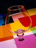 Exponeringsglas av cognacen med färger Royaltyfri Fotografi