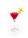 Exponeringsglas av den röda alkoholdrycken med carambolaen Arkivbild