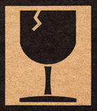 exponeringsglas av det bräckliga symbolet på papp Arkivfoto