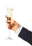 Exponeringsglas av mousserande champagne i hand Royaltyfria Foton