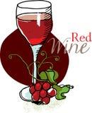 Exponeringsglas av rött vin och druvor Arkivbilder