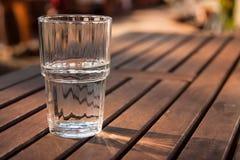 Exponeringsglas av vatten Arkivbild