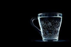 Exponeringsglas av vatten med bubblor Fotografering för Bildbyråer