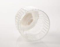 exponeringsglas- eller godiskrus på en bakgrund Arkivbild