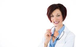 Exponeringsglas för kläder för öga för kvinnaoptiker- eller optometrikerinnehav, fotografering för bildbyråer