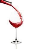 exponeringsglas hälld rött vin Royaltyfri Bild