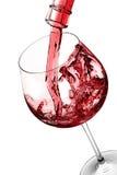 exponeringsglas hälld rött vin fotografering för bildbyråer