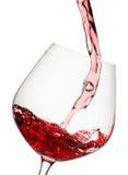 exponeringsglas hälld rött vin Arkivbild