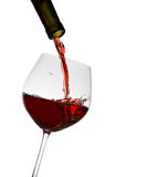 exponeringsglas hälld rött vin Arkivfoto