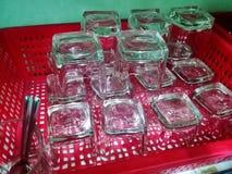 Exponeringsglas i röd korg Fotografering för Bildbyråer