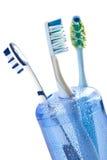 exponeringsglas isolerade tre tandborstar Fotografering för Bildbyråer