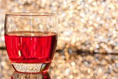 Exponeringsglas med drinken Royaltyfri Fotografi