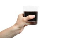 Exponeringsglas med en drink i vänstersidahanden Arkivfoto