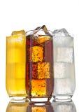 Exponeringsglas med orange sodavatten för cola och lemonadis arkivfoton