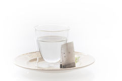 Exponeringsglas med varmvatten och te Fotografering för Bildbyråer