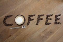 Exponeringsglas och bönor för kaffekopp Arkivbild