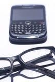Exponeringsglas och celltelefonen Arkivbild