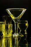 Exponeringsglas och exponeringsglas markerade vid kulört ljus på en svart bakgrund Royaltyfri Fotografi