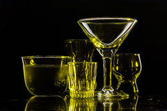 Exponeringsglas och exponeringsglas markerade vid kulört ljus på en svart bakgrund Arkivfoton