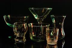 Exponeringsglas och exponeringsglas markerade vid kulört ljus på en svart bakgrund Arkivbild