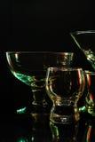 Exponeringsglas och exponeringsglas markerade vid kulört ljus på en svart bakgrund Royaltyfria Foton